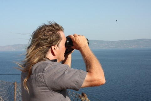 Eric Kempson watches for boats