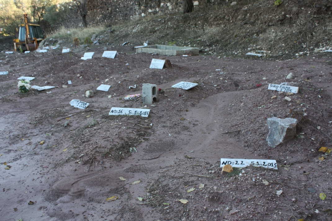 Refugee graves occupy the furthest corner of the graveyard