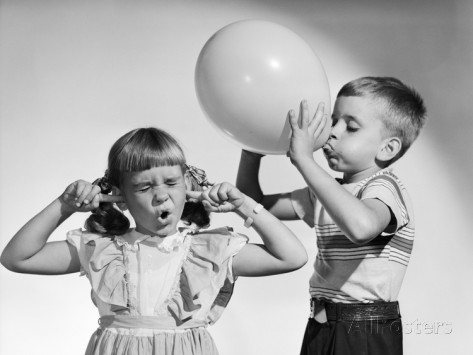 1950s-little-boy-blowing-up-big-balloon-little-girl-with-fingers-in-ears-eyes-closed